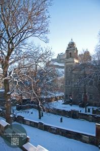 Edinburgh Castle and St Cuthbert's Church in snow