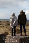couple standing on a concrete pillar at Gullane